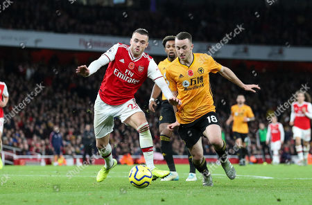 Diogo Jota of Wolves  goes round Calum Chambers of Arsenal in the area