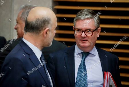 Pierre Moscovici (L), the European Commissioner for Economic and Financial Affairs and Taxation and European Commissioner for the Security Union Julian King (R) converse during the weekly college meeting of the European Commission in Brussels, Belgium, 30 October 2019.