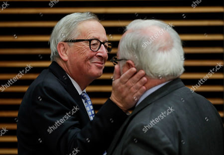 European Commission President Jean-Claude Juncker (L) and European Commissioner for climate action and energy Miguel Arias Canete (R), converse during the weekly college meeting of the European Commission in Brussels, Belgium, 30 October 2019.