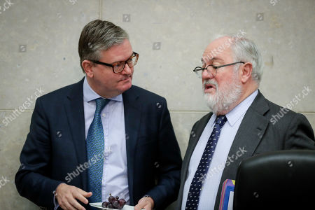 European Commissioner for the Security Union, Julian King (L), and European Commissioner for climate action and energy Miguel Arias Canete (R) converse during the weekly college meeting of the European Commission in Brussels, Belgium, 30 October 2019.