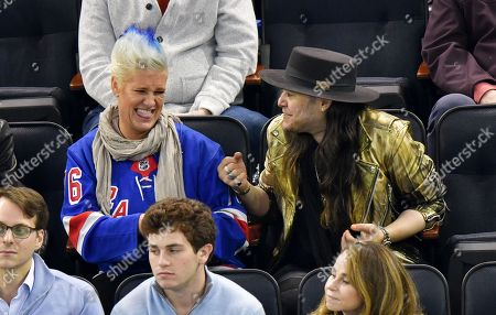 Stock Photo of Anne Burrell and guest attend Tampa Bay Lightning vs New York Rangers game at Madison Square Garden