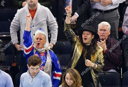 Stock Image of Anne Burrell and guest attend Tampa Bay Lightning vs New York Rangers game at Madison Square Garden