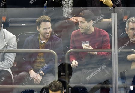Thomas Middleditch and guest (L) attend Tampa Bay Lightning vs New York Rangers game at Madison Square Garden