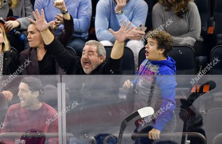 Thomas Middleditch, guest and Gaten Matarazzo attend Tampa Bay Lightning vs New York Rangers game at Madison Square Garden