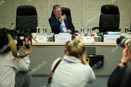 European Security Commissioner Julian King gestures during a College of Commissioners meeting at the EU headquarters in Brussels, . Britons will be heading out to vote in the dark days of December after the House of Commons on Tuesday backed an early national vote that could break the country's political impasse over Brexit, or turn out to be merely a temporary distraction
