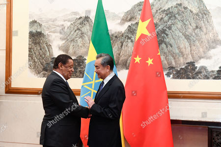 Stock Image of Former Ethiopian President Mulatu Teshome (L) shakes hands with Chinese State Councilor and Foreign Minister Wang Yi (R) at the Diaoyutai State Guesthouse in Beijing, China, 30 October 2019.