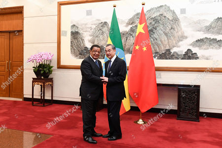 Stock Picture of Former Ethiopian President Mulatu Teshome (L) shakes hands with Chinese State Councilor and Foreign Minister Wang Yi (R) at the Diaoyutai State Guesthouse in Beijing, China, 30 October 2019.
