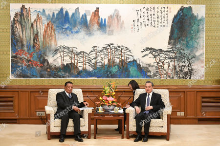 Former Ethiopian President Mulatu Teshome (L) and Chinese State Councilor and Foreign Minister Wang Yi (R) attend a meeting at the Diaoyutai State Guesthouse in Beijing, China, 30 October 2019.