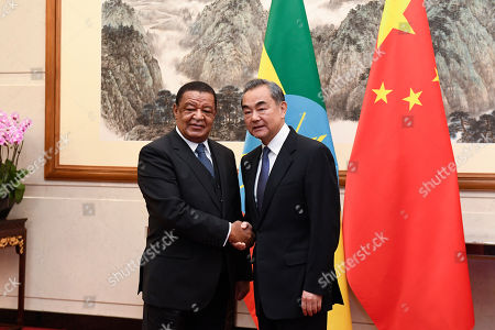 Former Ethiopian President Mulatu Teshome (L) shakes hands with Chinese State Councilor and Foreign Minister Wang Yi (R) at the Diaoyutai State Guesthouse in Beijing, China, 30 October 2019.