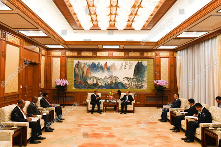 Stock Photo of Former Ethiopian President Mulatu Teshome (C-L) speaks during a meeting with Chinese State Councilor and Foreign Minister Wang Yi (C-R) at the Diaoyutai State Guesthouse in Beijing, China, 30 October 2019.
