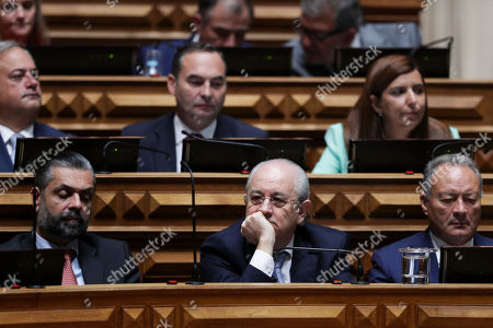The President of the principal opposition party Social Democratic Party (PSD) Rui Rio (C- front row) reacts during the presentation and debate on the Program of the XXII Constitutional Government at the Parliament in Lisbon, Portugal, 30 October 2019.