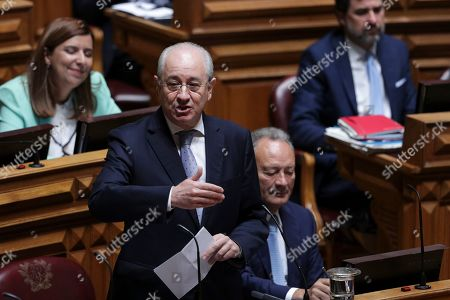 Stock Picture of The President of the principal opposition party Social Democratic Party (PSD) Rui Rio (C) speaks during the presentation and debate on the Program of the XXII Constitutional Government at the Parliament in Lisbon, Portugal, 30 October 2019.
