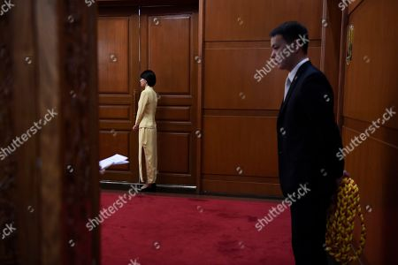 Workers wait on outside the room for a meeting between former Ethiopian President Mulatu Teshome and Chinese State Councilor and Foreign Minister Wang Yi at the Diaoyutai State Guesthouse in Beijing