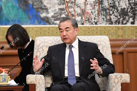 Chinese State Councilor and Foreign Minister Wang Yi speaks during a meeting with former Ethiopian President Mulatu Teshome at the Diaoyutai State Guesthouse in Beijing