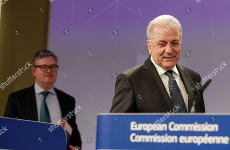 Stock Photo of European Comissioner of Migration Dimitris Avramopoulos (R) and European Commissioner for Security Union, British Julian King (L) arrive to give a press conference on progress made towards an effective and genuine Security Union at the European Commission in Brussels, Belgium, 30 October 2019.