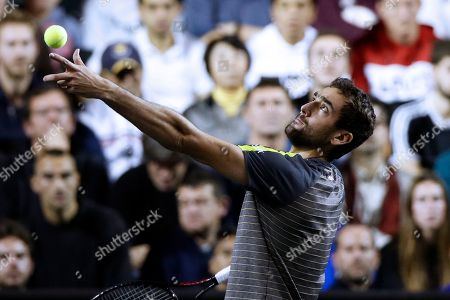 Marin Cilic of Croatia in action against Stan Wawrinka of Switzerland during their second round match at the Rolex Paris Masters tennis tournament in Paris, France, 30 October 2019.