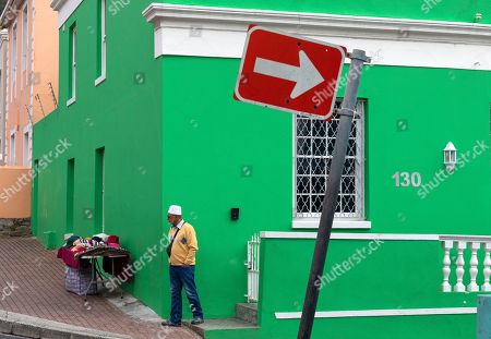 A resident of the Bo-Kaap neighborhood walks in Cape Town, South Africa, 30 October 2019. The Bo-Kaap Civic and Ratepayers Association has been awarded a gold certificate at the 2019 Simon van der Stel Awards for its efforts to preserve the heritage of their area. A one billion Rand development on the fringes of the Bo-Kaap was halted by residents in a clash with police in November last year. The Bo-Kaap neighborhood on Signal Hill dates back to the establishment of a Dutch colony on the Cape of Good Hope in the seventeenth century. It is a multi-ethnic and multi-lingual community composed of descendants from South and Southeast Asian nations who had been forcibly relocated to supply skilled labor for the expanding Cape Colony. The Bo-Kaap is recognized globally for its distinctive vernacular architecture and its enduring Muslim culture. The district preserves the largest collection of pre 1850 architecture in South Africa including the countries oldest mosques.  The Bo-Kaap has also been proposed to become South Africa?s first official Lego set. The idea came after Lego fan Wayne Nestadt entered his recreation of the area in the Lego Ideas competition.