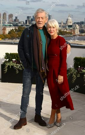 Sir Ian McKellen, Dame Helen Mirren. Actors Sir Ian McKellen and Dame Helen Mirren pose for photographers upon arrival at the photo call of 'The Good Liar' at a central London hotel