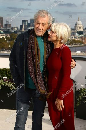 Sir Ian McKellen, Dame Helen Mirren. Actors Sir Ian McKellen, left, and Dame Helen Mirren pose for photographers upon at the photo call for the film 'The Good Liar' at a central London hotel