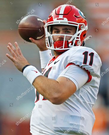 Georgia quarterback Jake Fromm (11) throws to a receiver during warmups before an NCAA college football game against Tennessee, in Knoxville, Tenn. The SEC hasn't had a quarterback picked in the first round of the NFL draft since Johnny Manziel in 2014, and the league has never had more than one quarterback taken in the first round. It appears that's about to change, as Tua Tagovailoa, Joe Burrow and possibly Jake Fromm could make the next draft the best ever for SEC quarterbacks