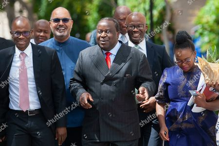 South African Finance Minister Tito Mboweni (C) arrives to deliver the mid-term budget statement at parliament, Cape Town, South Africa, 30 October 2019.  South Africa's unemployment rate has worsened to 29.1 percent the highest level in more than eleven years.
