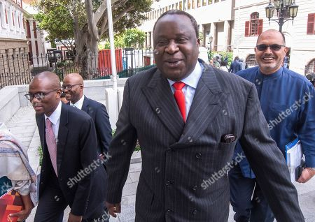 South African Finance Minister Tito Mboweni (C) arrives to deliver the mid-term budget statement at parliament, Cape Town, South Africa, 30 October 2019. South Africa's unemployment rate has worsened to 29.1 percent, the highest level in more than eleven years.