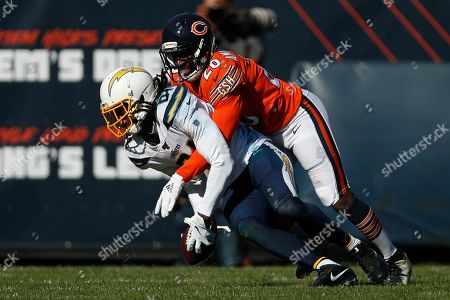 Prince Amukamara, Mike Williams. Chicago Bears cornerback Prince Amukamara (20) brings down Los Angeles Chargers wide receiver Mike Williams (81) after a catch during an NFL football game, in Chicago