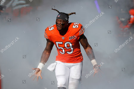A.J. Klein. Chicago Bears inside linebacker Danny Trevathan runs through smoke as he is introduced before an NFL football game against the Los Angeles Chargers, in Chicago