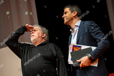 U.S. entrepreneur and co-founder of Apple Inc. Steve Wozniak (L) looks at the audience in the company of Maurice Lisi, head of the Multichannel and CRM Division of the Italian banking group Intesa Sanpaolo at the Novathon Conference in Budapest Congress Centre in Budapest, Hungary, 30 October 2019. The conference organized by CIB Bank is an event on finance innovation and digital culture transformation bringing together acclaimed international financial influencers to showcase excellence in banking and financial services.