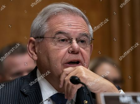 "Sen. Bob Menendez, the top Democrat on the Senate Foreign Relations Committee, questions Deputy Secretary of State John Sullivan, President Donald Trump's nominee to become the new U.S. ambassador to Russia, on Capitol Hill in Washington, . Menendez inquired about Trump's firing of U.S. Ambassador to Ukraine, Marie ""Masha"" Yovanovitch and pressuring that country's new president to investigate Democrats and the family of rival presidential contender Joe Biden"