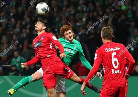 Heidenheim's Marnon Busch (L) in action against Bremen's Josh Sargent (C) during the German DFB Cup second round soccer match between SV Werder Bremen and FC Heidenheim in Bremen, northern Germany, 30 October 2019.