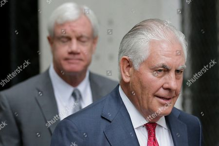 Former Exxon CEO and ex-Secretary of State Rex Tillerson leaves a courthouse in New York,. As Exxon faced the prospect of new climate regulations, the energy giant's leaders sought a full understanding of how they would affect the bottom line, Tillerson told a court Wednesday in a securities fraud lawsuit brought by the New York attorney general's office