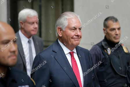 Stock Photo of Former Exxon CEO and ex-Secretary of State Rex Tillerson, second from the right, leaves a courthouse in New York,. As Exxon faced the prospect of new climate regulations, the energy giant's leaders sought a full understanding of how they would affect the bottom line, Tillerson told a court Wednesday in a securities fraud lawsuit brought by the New York attorney general's office
