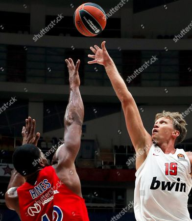 Stock Picture of Kyle Hines (L) of CSKA Moscow in action against Mindaugas Kuzminskas (R) of Olympiacos Piraeus during the Euroleague basketball match between CSKA Moscow and Olympiacos Piraeus in Moscow, Russia, 30 October 2019.