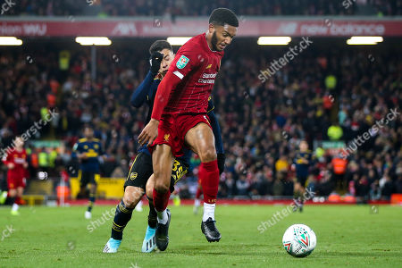 Joe Gomez of Liverpool takes on Gabriel Martinelli of Arsenal