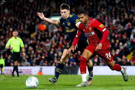 Rhian Brewster of Liverpool takes on Kieran Tierney of Arsenal