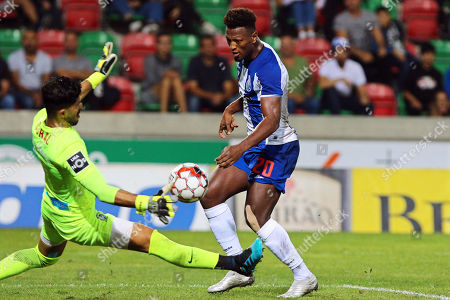 Maritimo's goalkeeper Amir Abedzadeh (L) in action against FC Porto's Ze Luis (R) during the Portuguese First League soccer match between Maritimo and FC Porto at Barreiros Stadium in Funchal, Portugal, 30 October 2019.