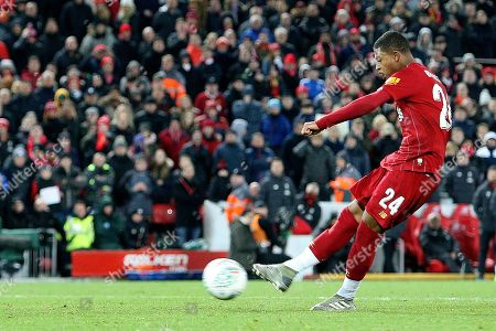 Liverpool forward Rhian Brewster (24) scores in the penalty shootout 3-2  during the EFL Cup match between Liverpool and Arsenal at Anfield, Liverpool