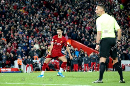 Liverpool midfielder Curtis Jones (48) scores the winning penalty 5-4 but glances at Referee Andre Marriner before running off to celebrate during the EFL Cup match between Liverpool and Arsenal at Anfield, Liverpool