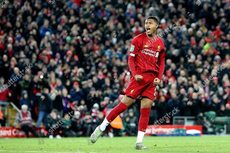 Liverpool forward Rhian Brewster (24) scores in the penalty shootout 3-2 and celebrates during the EFL Cup match between Liverpool and Arsenal at Anfield, Liverpool