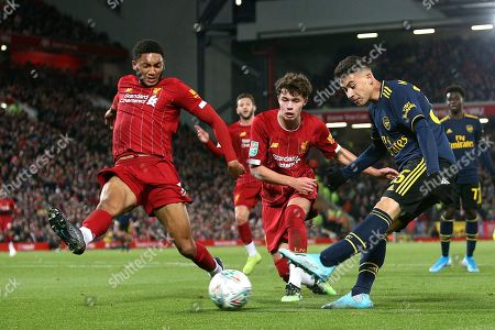 Stock Picture of Liverpool defender Joe Gomez (12) and Liverpool forward Neco Williams (76) try to stop the cross from Arsenal forward Gabriel Martinelli (35) during the EFL Cup match between Liverpool and Arsenal at Anfield, Liverpool