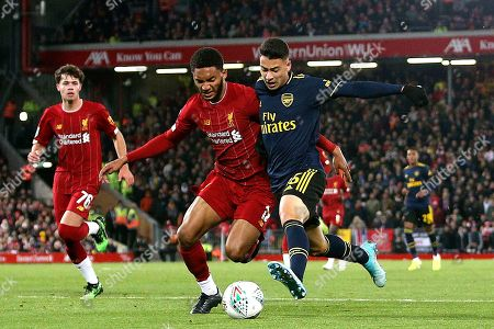 Stock Image of Liverpool defender Joe Gomez (12) and Arsenal forward Gabriel Martinelli (35)  during the EFL Cup match between Liverpool and Arsenal at Anfield, Liverpool