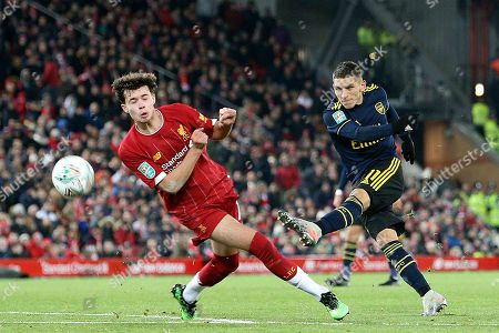 Arsenal midfielder Lucas Torreira (11) gets his shot in despite the attempted block from Liverpool defender Adam Lewis (46) during the EFL Cup match between Liverpool and Arsenal at Anfield, Liverpool