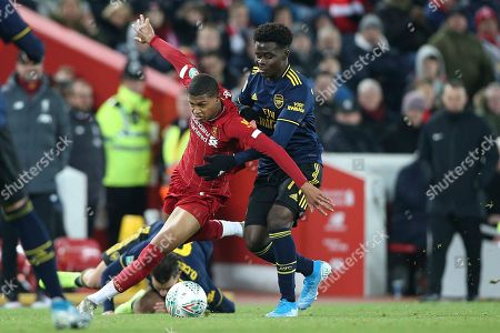Liverpool forward Rhian Brewster (24) tries to find a way past Arsenal forward Bukayo Saka (77) during the EFL Cup match between Liverpool and Arsenal at Anfield, Liverpool