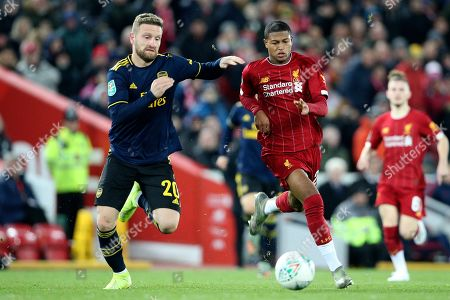 Liverpool forward Rhian Brewster (24) and Arsenal defender Shkodran Mustafi (20) during the EFL Cup match between Liverpool and Arsenal at Anfield, Liverpool