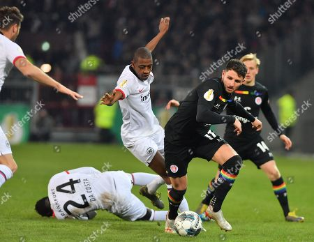 St.Pauli's Matt Penney (R) in action against Frankfurt's Danny Da Costa and Gelson Fernandes (L-R)  during the German DFB Cup 2nd round match between FC St. Pauli and Eintracht Frankfurt in Hamburg, Germany, 30 October 2019.