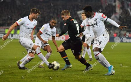 Frankfurt's David Abraham, Gelson Fernandes and Danny Da Costa (L-R) in action against St. Pauli's Viktor Gyoekeres (C) during the German DFB Cup 2nd round match between FC St. Pauli and Eintracht Frankfurt in Hamburg, Germany, 30 October 2019.