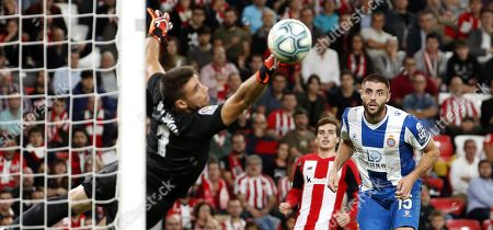 Athletic Bilbao's goalkeeper Unai Simon (L) in action against Espanyol's defender David Lopez Silva (R) during the Spanis LaLiga soccer match between Athletic Bilbao and Espanyol, held at the San Mames stadium in Bilbao, Basque Country, northern Spain, 30 October 2019.