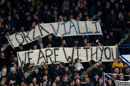 Chelsea fans hold a banner in support of former coach Gianluca Vialli who is fighting cancer before the English League Cup soccer match between Chelsea and Manchester United at Stamford Bridge in London