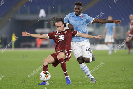 Lazio's Felipe Caicedo, right, and Torino's Diego Laxalt vie for the ball during the Italian Serie A soccer match between Lazio and Torino at Rome's Olympic stadium